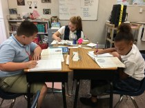 The-Christian-Academy-At-Bradenton,-Three-Students-Working-at-Desks